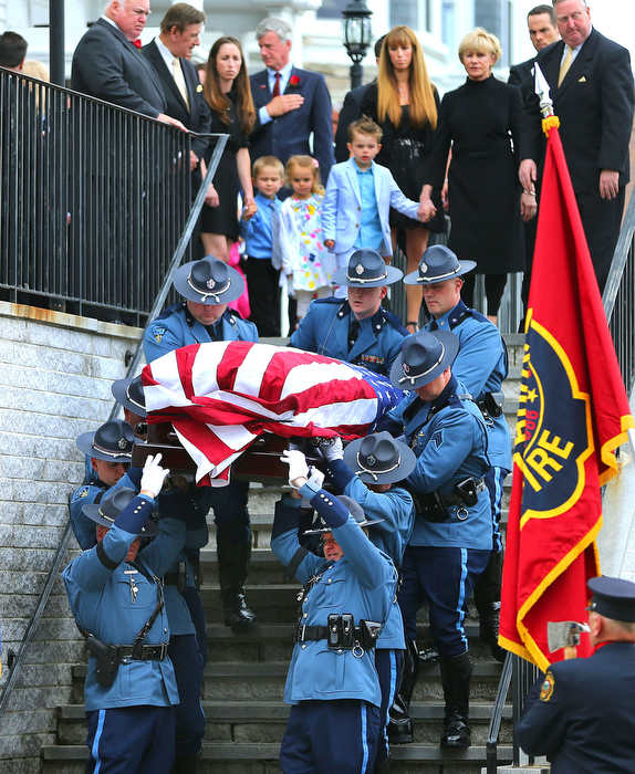 Hudson-06/14/13-  A funeral mass was held at Saint Michael Church for former Gov. Paul Cellucci , where friends, family and politicians attended.  Cellucci's wife Jan(right short hair) leads the family behind the State Police Pallbearers.