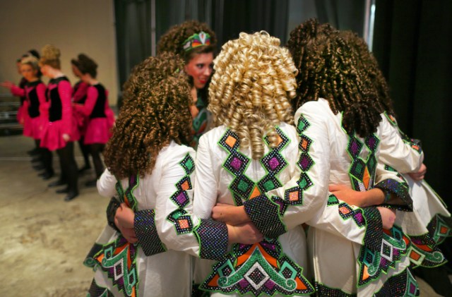 Boston-3/29/13-The Ryan-Kilcoyne School of Irish Dancing from Pennsylvania give a group hug  backstage moments before they went on stage in the 16-19 age group competition,  during The World Irish Dancing Championships being held at the Hynes Convention Center.  It is only the second time in it's 40 year history that the eight-day event is held outside Ireland and Scotland. Organizers expect twenty-thousand people from around the globe to attend the event.