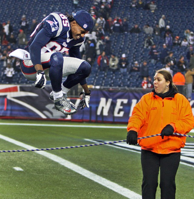 Patriots wide receiver Brandon Lloyd, who scored a touchdown in the game, leaps over a security rope as he heads off the field with a big smile following New England's 41-28 victory that propelled them to the AFC Championship. The New England Patriots hosted the Houston Texans in an NFL Divisional Playoff Game at Gillette Stadium.