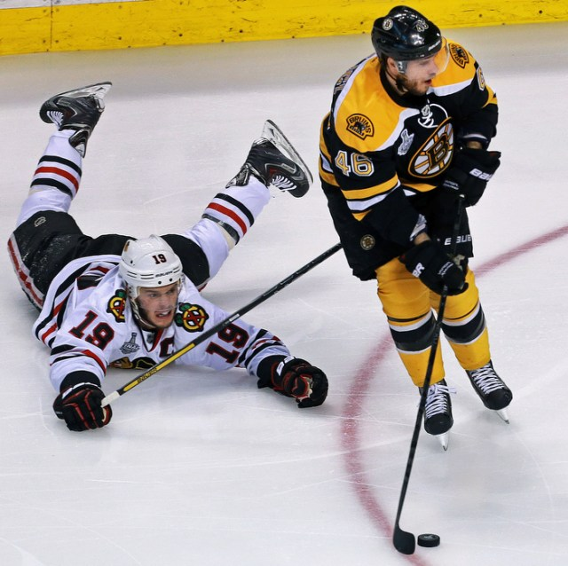 The Bruins David Krejci leaves Chicago' Jonathan Toews on the ice and in his wake.  The Boston Bruins hosted the Chicago Blackhawks for Game Six of the Stanley Cup Finals at the TD Garden.