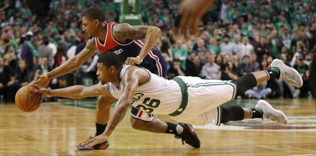 Washington Wizards guard Bradley Beal (T) and Boston Celtics forward Marcus Smart (B) dive for a loose ball during the second half of their NBA Eastern Conference Semifinal game seven at the TD Garden in Boston, Massachusetts, USA, 15 May 2017. The best of seven series is tied 3-3 and the winner of the game will go on to face the Cleveland Cavaliers in the Eastern Conference Finals.