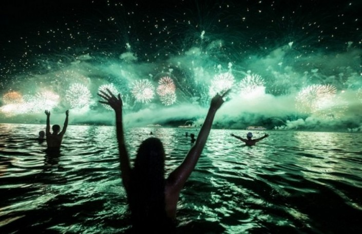 """""""Celebrating New Year 2014-People watch the fireworks across the water at Copacabana beach"""""""