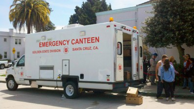 Coffee and pastries were provided to people as they waited to enter the Santa Cruz Civic Auditorium.