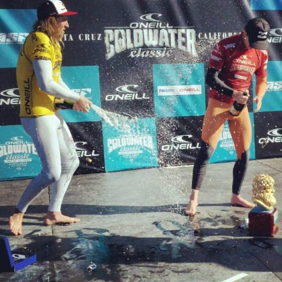 Runner up Matt Wilkinson sprays winner Taj Burrow with Champagne