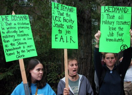 Students hold up signs with demands from the Students Against War