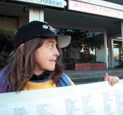 a women helps display the scroll on 41 Avenue