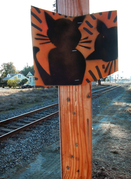 "the cats are ok, but the sign that says, ""Coastal Rail Trail Please enjoy"" was no longer posted"
