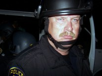 "This cop wore the name tag ""M. McDonald"" and was seen jabing people with his baton."
