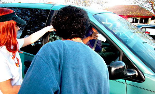 handing out information to a passing motorist