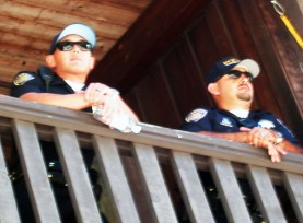 Two UC police officers were peering down on the rally in the Baytree Plaza