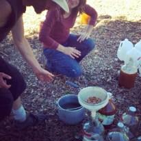 Steve strains freshly pressed juice into jugs