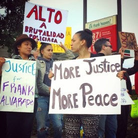 """Rally on July 12, 2014 at the corner of S Sanborn Rd & Fairview Ave in East Salinas against police violence and to demand justice for Frank Alvarado. Demonstrators, including friends and family from Santa Cruz and Monterey Counties, held signs such as """"Justice for Frank Alvarado"""", """"More Justice, More Peace"""", and """"Alto a Brutalidad Policiaca""""."""