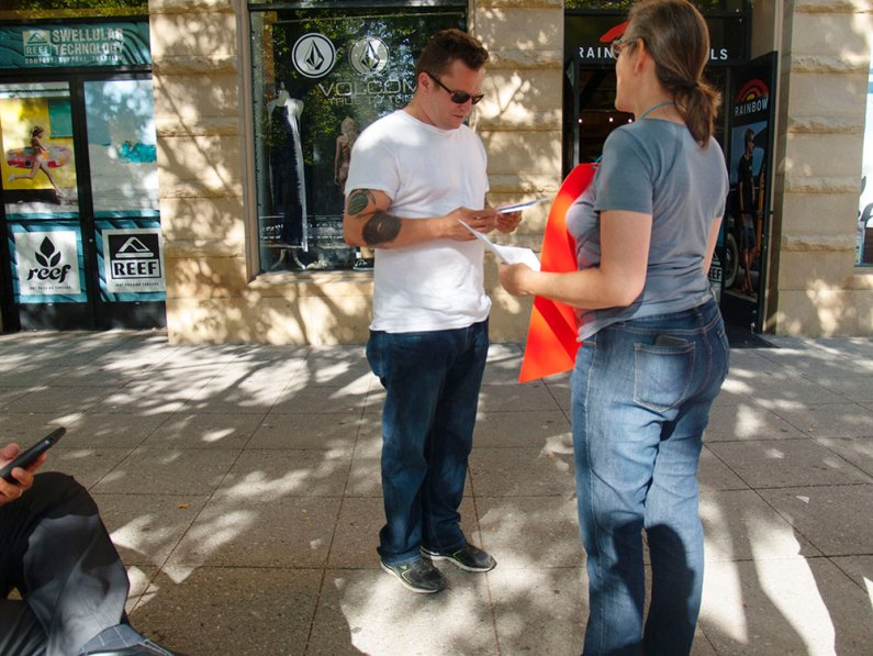 Leslie Potenzo Passes Out Flyers on Pacific Ave. to End Solitary Confinement