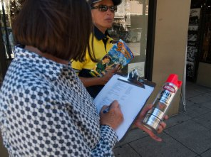 Red spray paint and a checklist are used to identify illegitimate boxes.