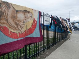 A rug and clothing hangs out to dry on a new wrought iron fence surrounding the triangular property on Soledad Street, Market Way, and Bridge Alley in Salinas Chinatown. The lot was previously utilized by homeless people living in tents.