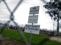 Lots previously utilized by homeless people in Salinas Chinatown, such as this one on Bridge Street, are now fenced off with signs declaring private property and no trespassing.