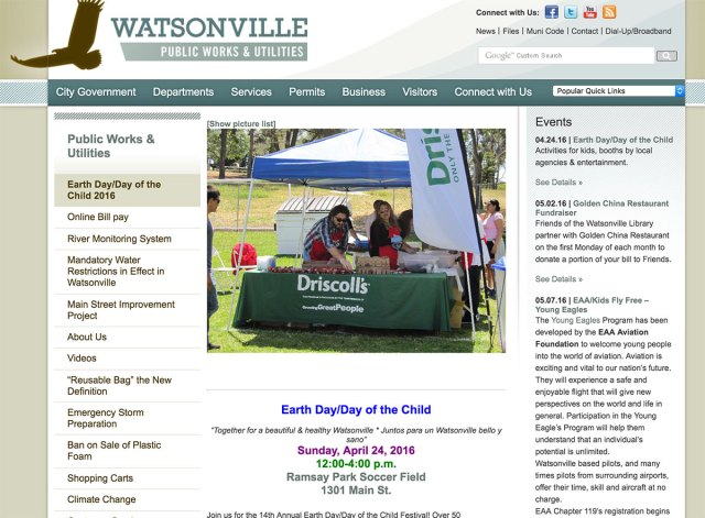 "An announcement for Watsonville Earth Day 2016  on the city's website features a large photo of Driscoll's booth and their slogan ""Growing Great People."""