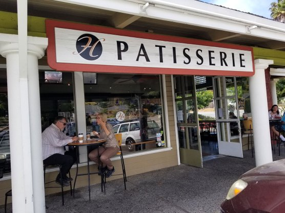 People eat lunch and talk while enjoying the outside seating Heather's Patisserie in Aptos.