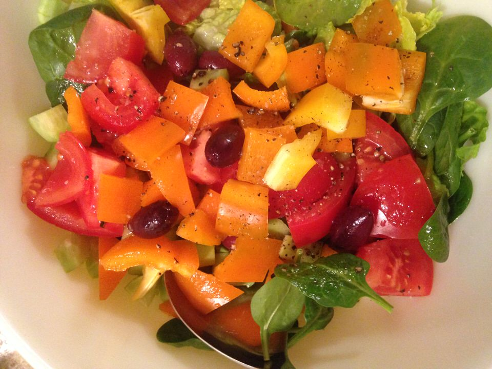 An Energizing Green Salad filled with vegetables and dressed with a balsamic vinaigrette