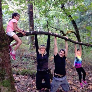 Move beyond exercise: a family hangs together on a tree