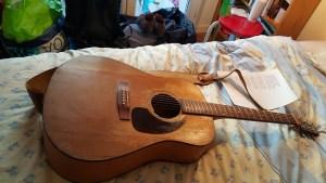 repaired guitar full view