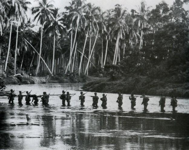 Guadalcanal: A U.S. Marine patrol crosses the Matanikau River in September 1942.