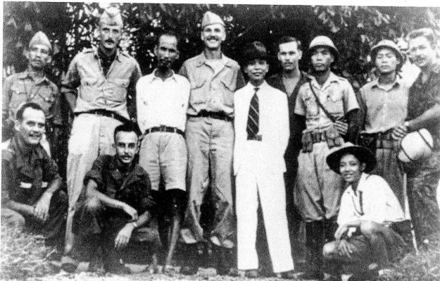Ho Chi Minh, third from left, stands with Americans of the OSS in 1945. Not sure, but I think that's Dewey to his left.