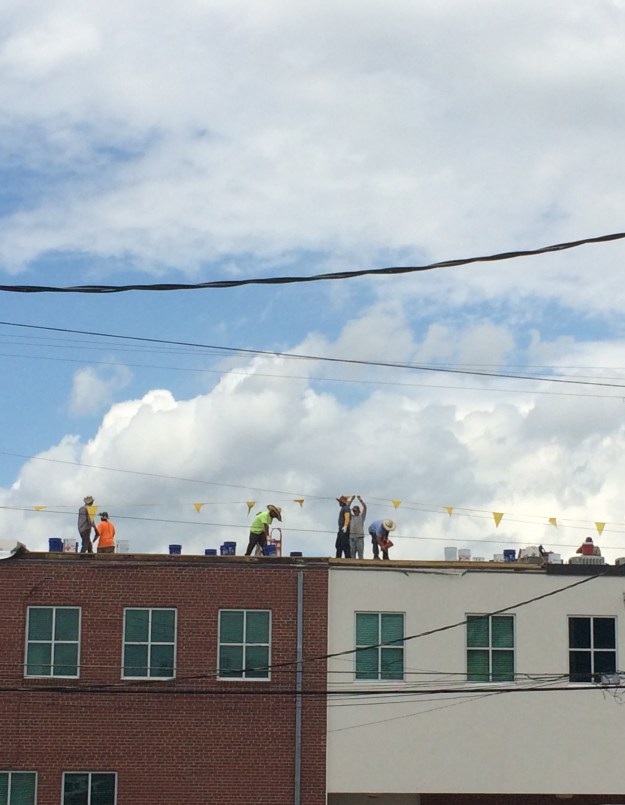 This was a disappointment. The sight of workers backed by the big, blue sky was way better IRL.
