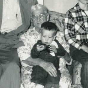 The old lady is the daughter of Henry Waller. The big-headed kid on her lap is me.