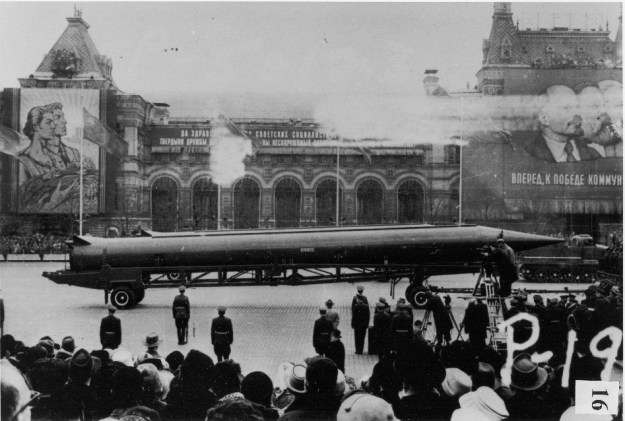 CIA photograph of Soviet medium-range ballistic missile in Red Square, Moscow, some time between 1959 and 1968. Imagine a giant pencil instead.