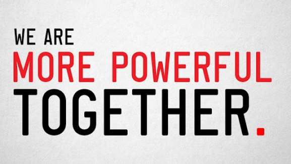 We are more powerful together words written in black and red.