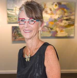 A photo of Gayle Miller at the Society of Bluffton Artists gallery.