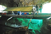 Baras Cave: The clear emerald water gives the impression that our banca is floating in mid-air.