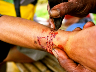 Before tattooing, a prayer to the Manobo god Manama is offered; then, using a sharp blade called 'burong', the skin is punctured following a pattern or design.