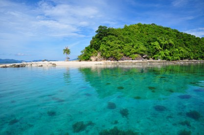 """By far, this islet just across Tangdan Beach is my favorite! Locals call it """"Palawan Camping"""". I call it heaven!"""