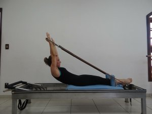 Woman exercising upper body with exercise bands