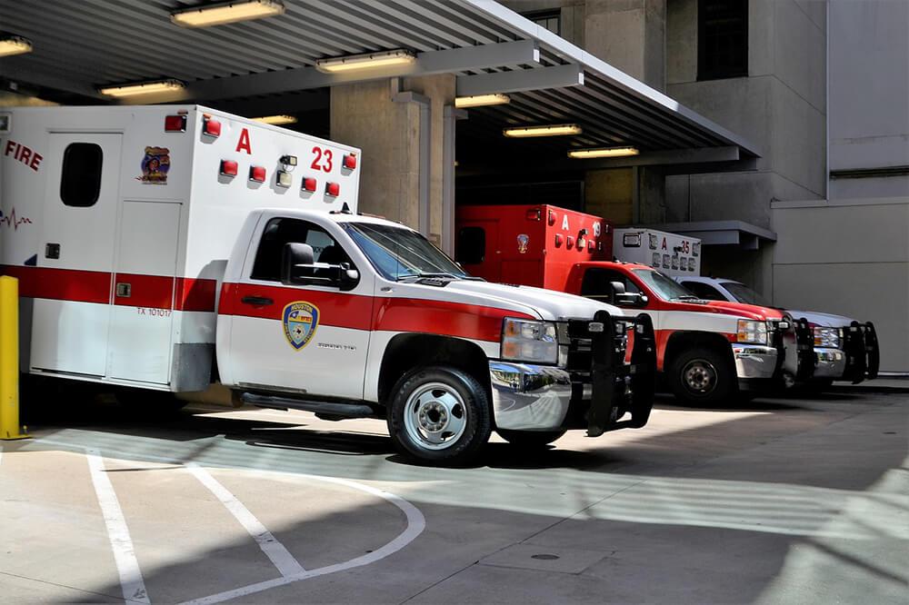 White Ambulance parked in hospital ambulance parking stall