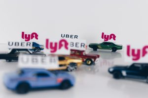 Ride-hailing service - cars with signs indicating Uber or Lyft services