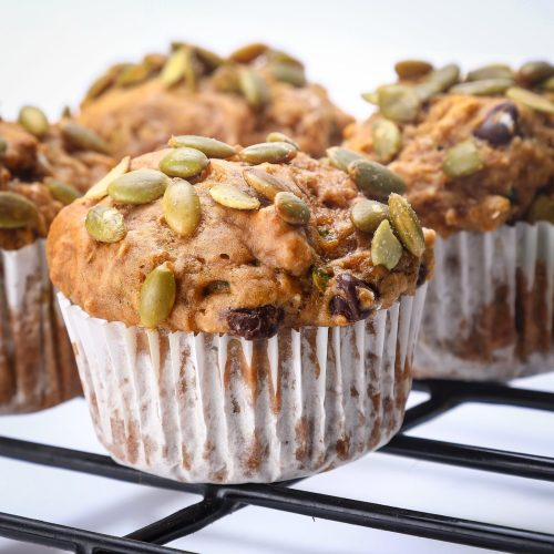 Vegan Zucchini reishi muffins recipe shown on a cooling rack