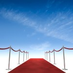 This is an image of a red carpet rolled out into a blue sky.