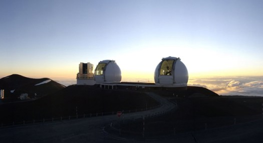 The Keck Interferometer, with the telescopes' doors open to equalize temperature inside and outside of the domes (Source: NASA/JPL) Credit: NASA/JPL