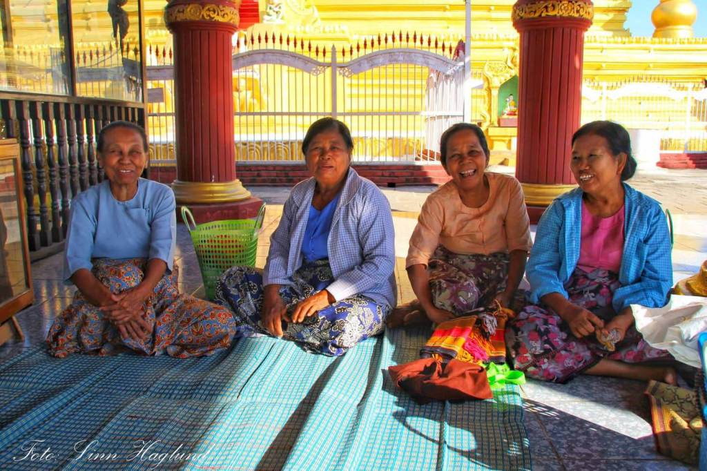 Women in Myanmar laughing after I had been sitting with them for a while communicating with sign language and smiles