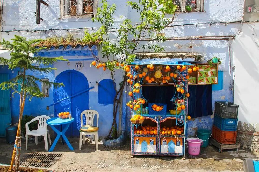 A beautiful orange juice kiosk