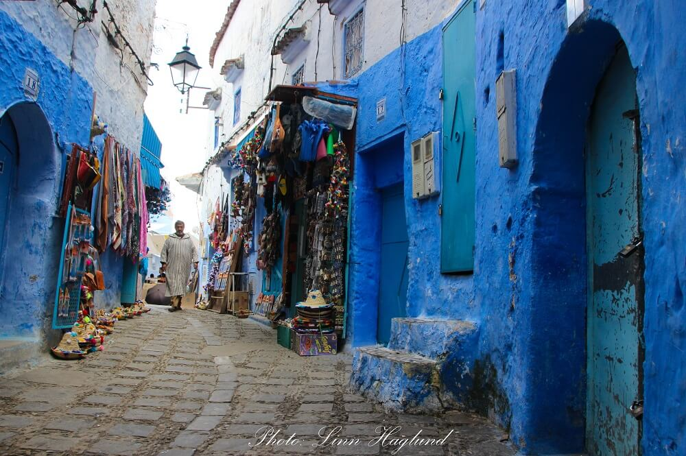 A local walking down one of the tiny streets of the medina