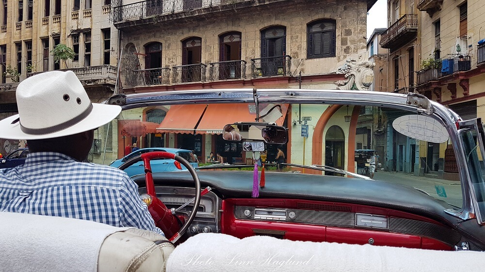 A vintage taxi tour in Havana is a good way to support the locals