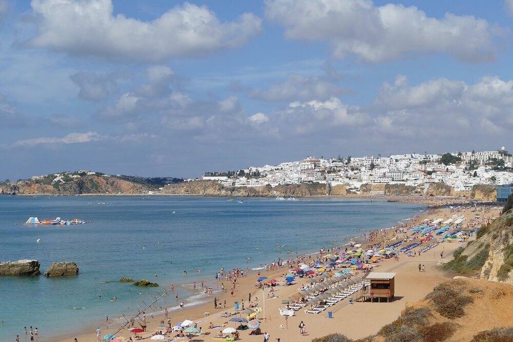 Albufeira beach shoul dbe on your Algarve road trip itinerary