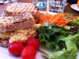 Toasta Mixta - Portuguese Grilled Cheese With Eggs, Ham, Brie, Onions, Mustard Served With Mesclun Salad