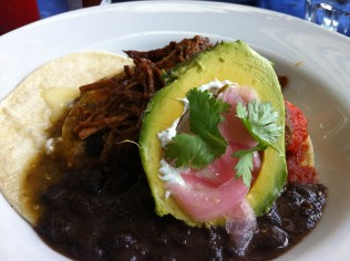Huevos Divorciados: Corn Tortillas, Poached Eggs, Cheddar, Black Beans, Avocado, Mexican Crema, Salsa verde y roja With Pulled Pork