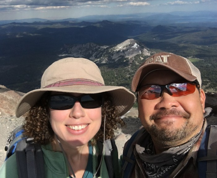 A selfie of Michael and Christina at the top of Lassen Peak