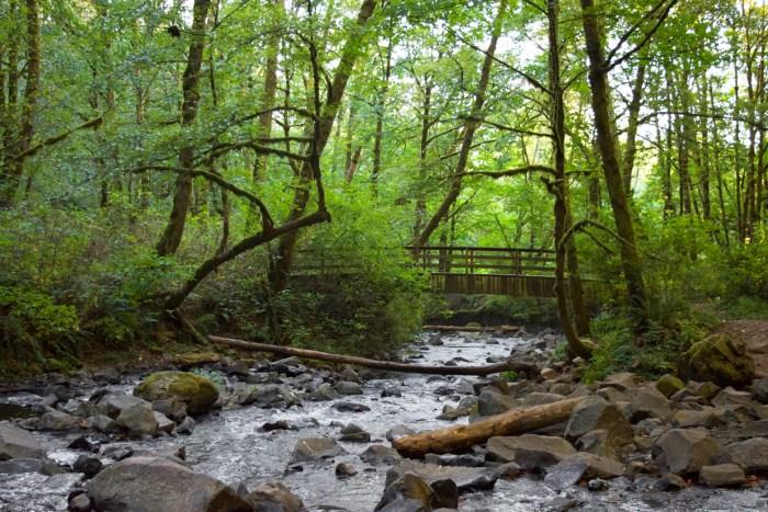 View of the creek downstream of Bridal Veil Falls where a bridge crosses the creek